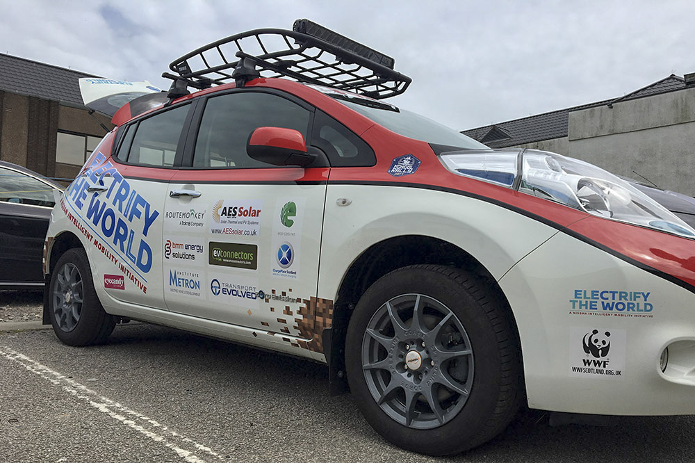 The Mongol Rally Nissan LEAF car pictured with the AES Solar and other sponsorship logos