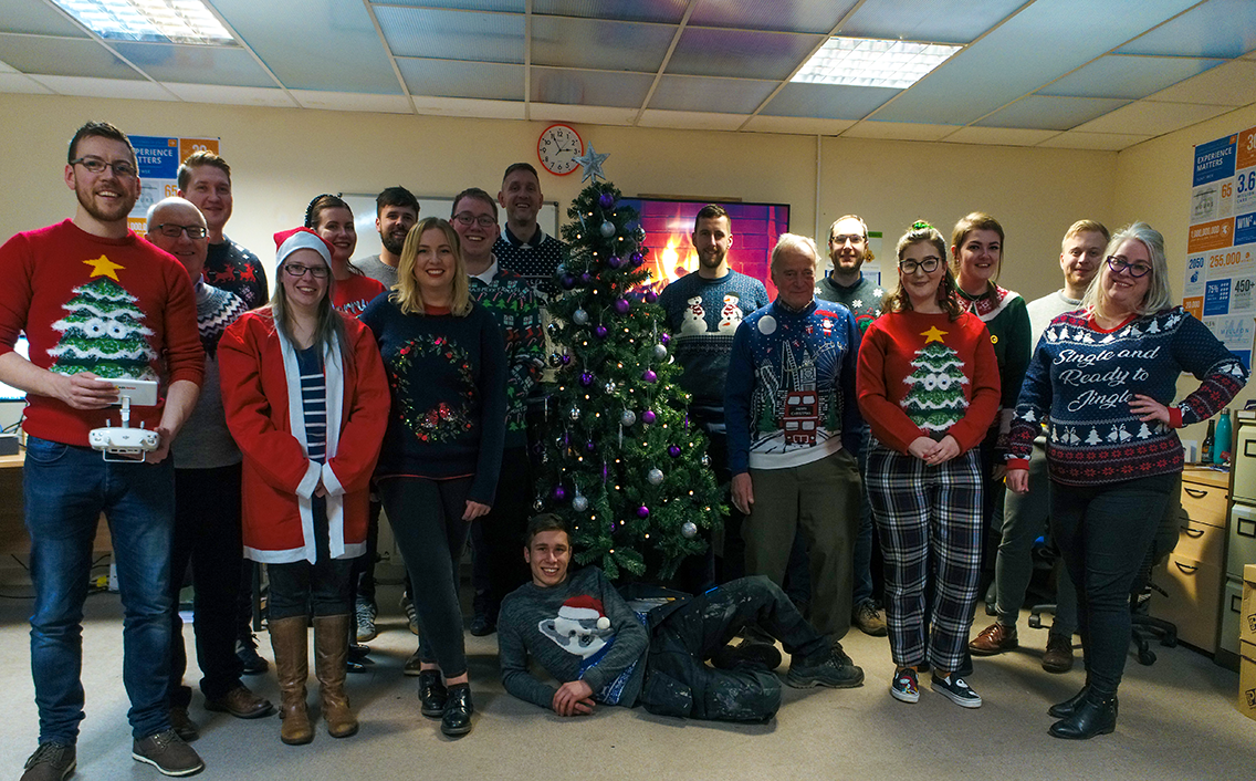 AES Solar gather round the tree for a festive photo