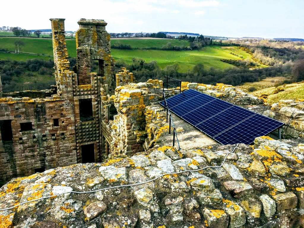 Derelict castle with solar panels for AES Solar year review