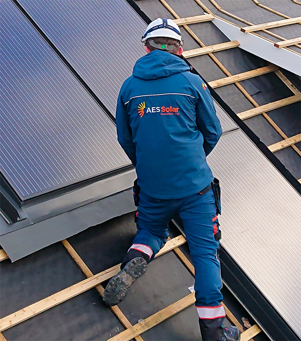One of our installers pictured in the new AES Solar workwear.